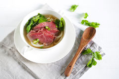 Beef soup from Vietnam, pho, raw meat garnished with coriander and chili Royalty Free Stock Photos