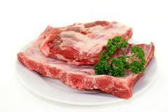 Beef spare ribs. Two pieces of spare ribs on a white background Royalty Free Stock Image