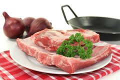 Beef spare ribs. Two pieces of spare ribs on a white background Stock Photos
