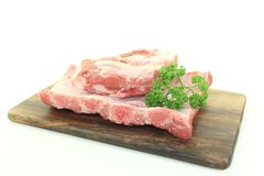 Beef spare ribs. With parsley on a wooden board Stock Photo