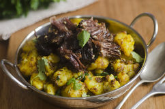 Beef with spiced potatoes Royalty Free Stock Images