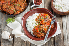 Beef in a spicy tomato sauce with rice Stock Photos