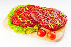 Beef stake in marinade Stock Images