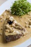 Beef steak. In mushroom sauce Royalty Free Stock Image