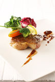 Beef steak. Grilled beef steak with brown gravy sauce. garnishing with baby carrot and organic vegetable Royalty Free Stock Photography