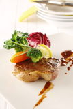 Beef steak. Grilled beef steak with brown gravy sauce. garnishing with baby carrot and organic vegetable Stock Photo
