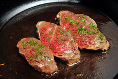 Beef Steak. Slices of beef on a frying pan Stock Photo