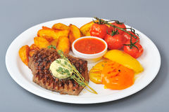 Beef steak. Roasted beef steak with butter and savory royalty free stock photo