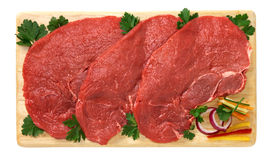 Beef steak. On wooden board Royalty Free Stock Photography