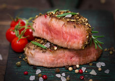 Beef steak. On the table close up Stock Images