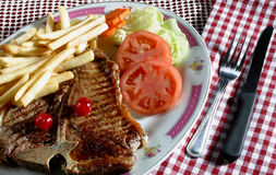 Beef steak. A beef steak with French fries stock photo