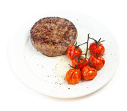 Beef steak and baked tomatoes Stock Photography