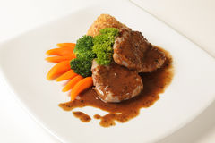 Beef steak with black pepper sauce stock photos