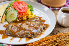Beef steak with black pepper sauce , salad and French fries on s Stock Photography