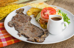 Beef steak with black pepper sauce , salad and French fries on s Royalty Free Stock Photo
