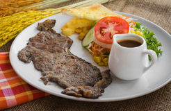 Beef steak with black pepper sauce , salad and French fries on s Royalty Free Stock Images