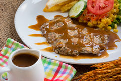 Beef steak with black pepper sauce , salad and French fries on s Stock Images