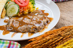 Beef steak with black pepper sauce , salad and French fries on s Royalty Free Stock Image