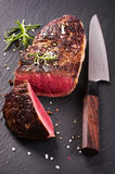 Beef Steak on black Slate Royalty Free Stock Image