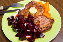 Beef steak with carrots and beetroots Stock Photography