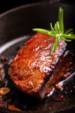 Beef steak on cast iron skillet Royalty Free Stock Photos