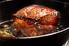Beef steak on cast iron skillet Royalty Free Stock Photography