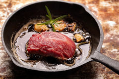 Beef steak on cast iron skillet Stock Images