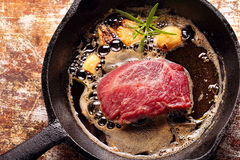 Beef steak on cast iron skillet Royalty Free Stock Images