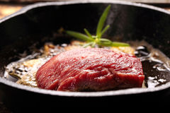 Beef steak on cast iron skillet Stock Photography