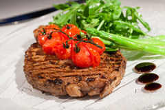 Beef steak. With cherry tomatoes and asparagus Royalty Free Stock Images