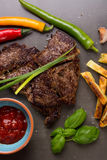 Beef steak and chips Royalty Free Stock Images