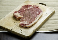 Beef Steak. On the chopping board Royalty Free Stock Photos