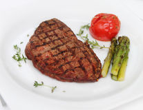 Beef steak with cooked asparagus Stock Photos