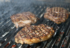 Beef steak cooking Royalty Free Stock Photos