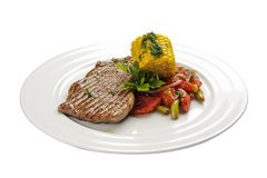 Beef steak with corn and vegetables. royalty free stock photos