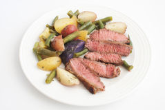 Beef steak cut with potato salad Stock Photos