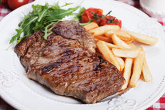 Beef steak with french fries Royalty Free Stock Images