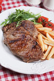 Beef steak with french fries Royalty Free Stock Photo