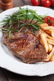Beef steak with french fries Stock Photography