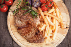 Beef steak with french fries Royalty Free Stock Image