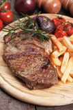 Beef steak with french fries Royalty Free Stock Photography