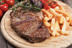 Beef steak with french fries Stock Photos
