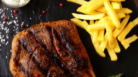 Beef steak with french fries and sauce stock video