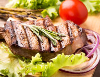 Beef steak with fresh herbs Stock Photography