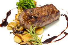 Beef steak with fried mushroom Stock Photography