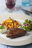 Beef steak with fries Stock Images