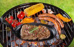 Beef steak on garden grill Stock Photo