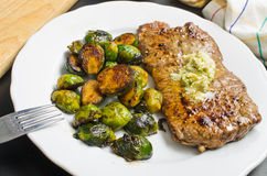 Beef steak with garlic butter and brussel sprouts Stock Images