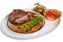 Beef steak with garnish. Beef steak with a salad of tomato, young shoots of bamboo and boiled potatoes royalty free stock image