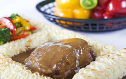 Beef steak in gravy with vegetables Stock Images